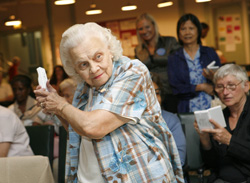 In this photo provided by Nintendo, Lillian Faybik, 87, of Manhattan, plays baseball on the Wii from Nintendo, Friday, Sept. 28, 2007, at The Carter Burden Center for the Aging in New York. Nintendo visited the center to show off video games that appeal to adults. (Nintendo Photo by Diane Bondareff)